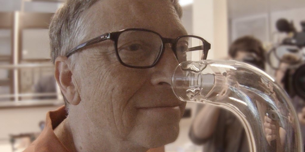 Photo of Bill Gates sniffing a tube containing \